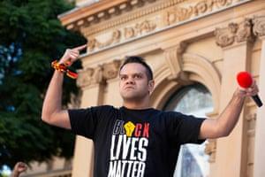 Meyne Wyatt speaks to protesters outside Sydney Town Hall
