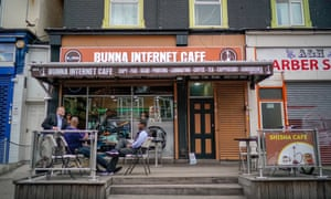 Customers sit outside the Bunna internet cafe.