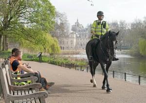 London, UK. Police patrol St James's Park in central London