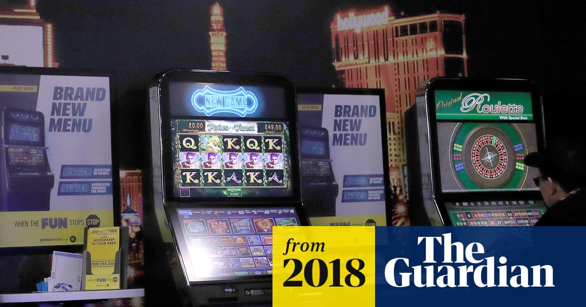 Maximum stake for fixed-odds betting terminals cut to £2 | UK news