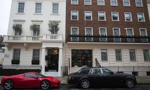 Luxury cars parked in Kensington, London