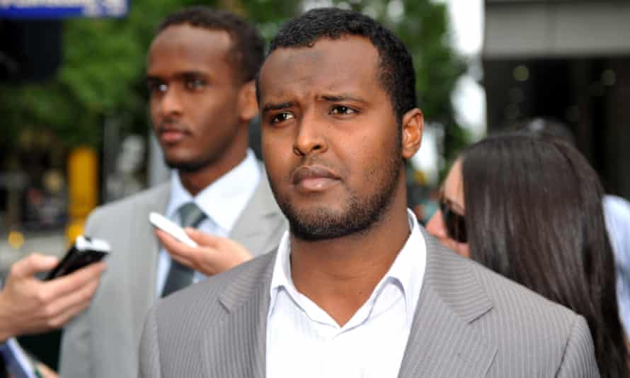 Yacqub Khayre (centre) and Abdirahman Ahmed (left) leave court in Melbourne in December 2010 after being acquitted of planning an alleged terrorist attack on the Holsworthy army base in Sydney.