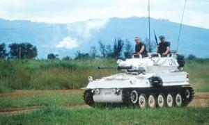 A UN tank helps civilians evacuate from Kigali, Rwanda, 1994.