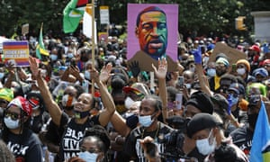 People participate in a Black Lives Matter rally in Brooklyn, in New York, last June.