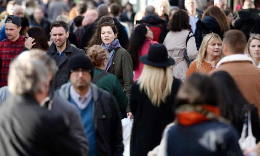 People walking down a busy street.