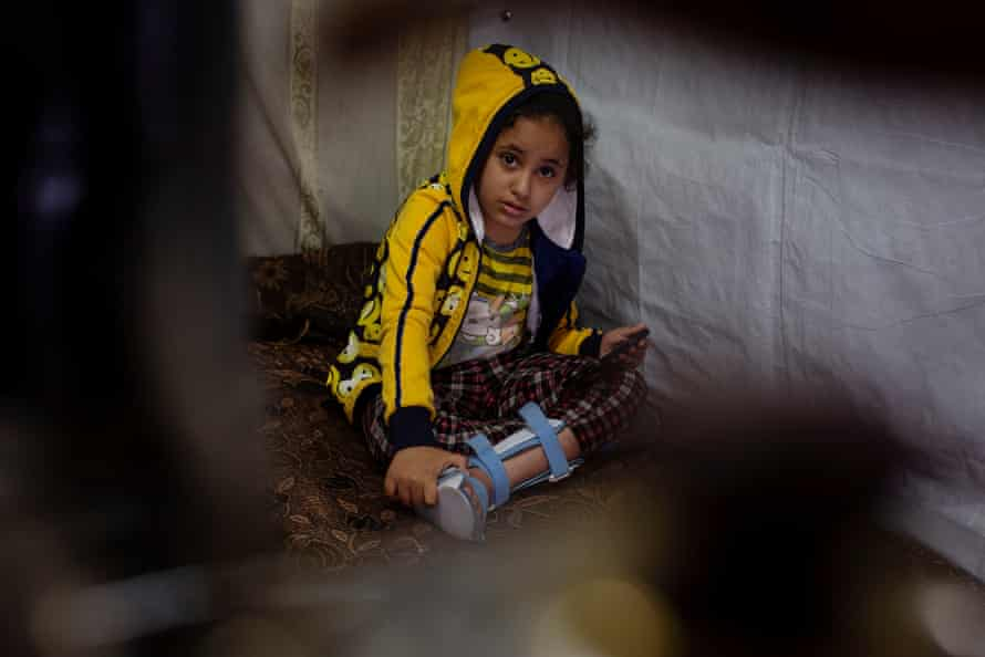 Nada, who is eight years old and no longer able to walk, sits in her family shelter in Zahlé, Lebanon, 25 March 2021