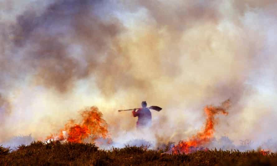 Burning the gorse on Dartmoor near Haytor England