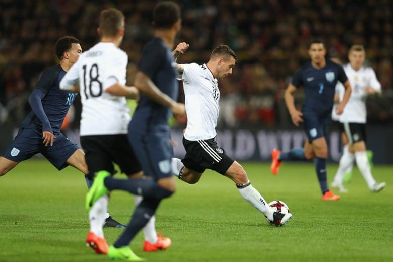 Podolski fires home the opener.