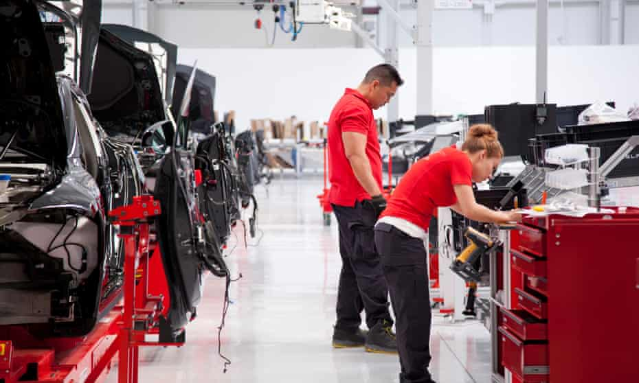 Tesla workers in the Fremont factory.
