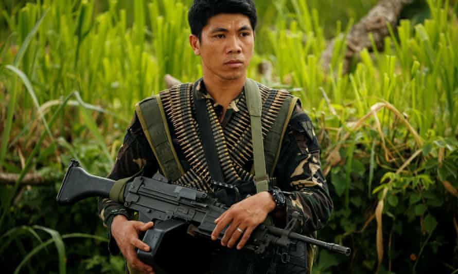 A Philippines army soldier guards a road during an operation to retrieve bodies of victims from the fighting zone in Marawi City.