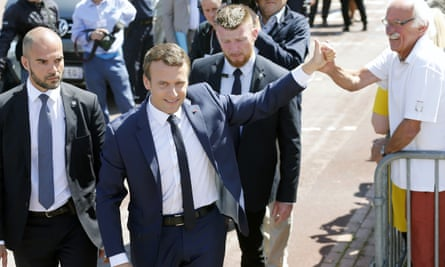 Emmanuel Macron leaves after casting his vote in the first round of the French legislative elections on Sunday