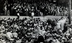 Roy Bentley at the microphone as he addresses an excited crowd at Stamford Bridge on 23 April 1955, the day Chelsea clinched the First Division championship with a 3-0 victory against Sheffield Wednesday.
