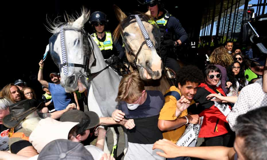 Mounted police attempt to break up a climate protest outside a mining conference at the Melbourne Exhibition and Convention Centre. More than 20 people were arrested and one protester was taken to hospital