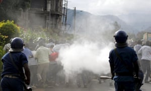 Riot police spray teargas on residents participating in street protests against the decision to allow President Pierre Nkurunziza to run for a third five-year term in office.
