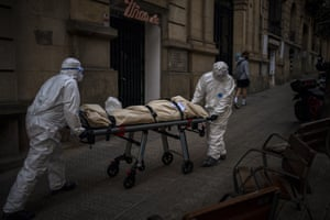 Barcelona, SpainMortuary workers carry the body of an elderly person who died of Covid-19 in a nursing home