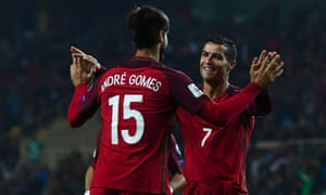 Cristiano Ronaldo celebrates with Andre Gomes after completing his hat-trick