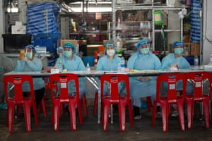 Health workers wait for patients at the Bang Khae Market during a mass vaccination program in Bangkok, Thailand on 18 March, 2021