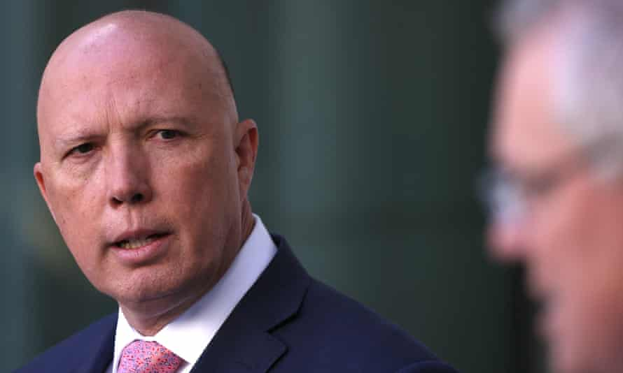 The minister for home Affairs Peter Dutton with the prime minister Scott Morrison at a press conference
