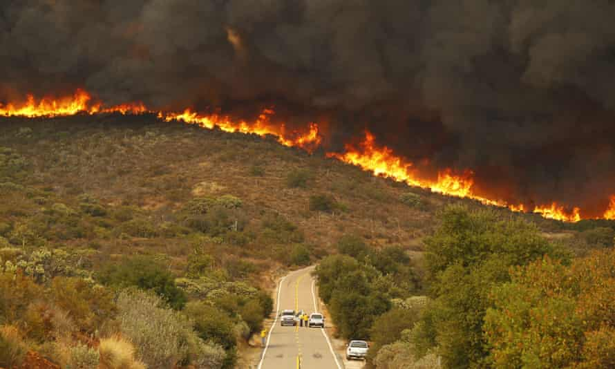 San Diego Sheriffs and CDF firefighters stage on Lyons Valley Road during the Valley Fire on Sunday