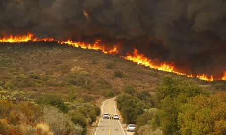 San Diego Sheriffs and CDF Firefighters perform on Lyons Valley Road during the Valley Fire on Sunday