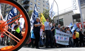 Protesters rally in support of food delivery riders in Sydney on Wednesday.