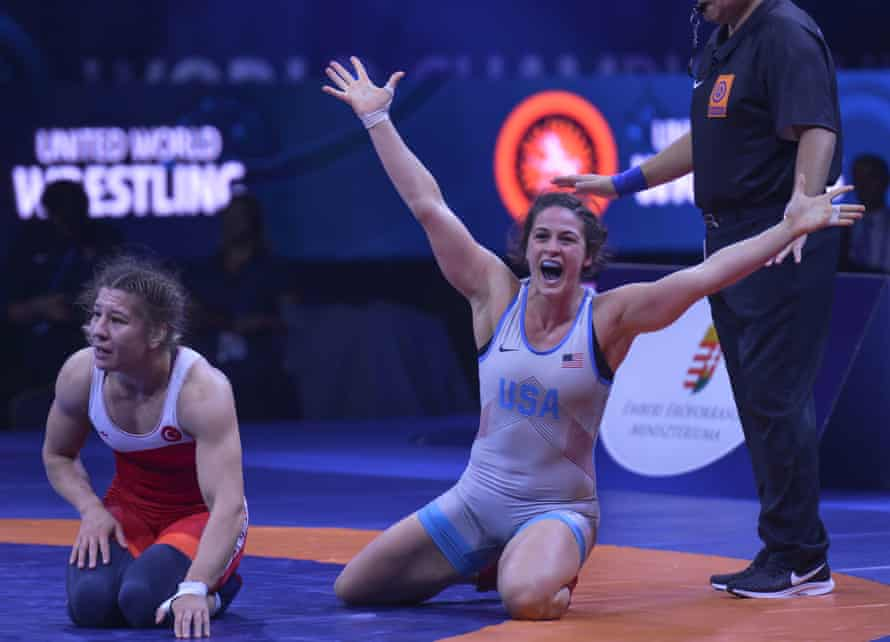 Adeline Gray (right calebrates her win against Yasemin Adar in their gold medal fight in women's freestyle wrestling 76kg category at the 2018 World Wrestling Championships.