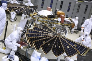 Technicians inspect the InSight lander's solar arrays before launch.