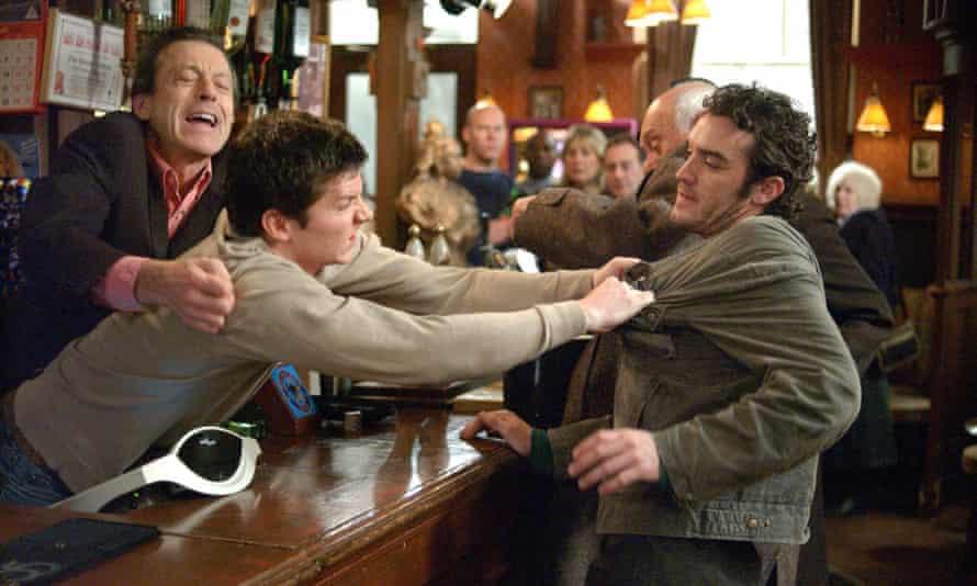Leslie Grantham as Den Watts intervenes as Den's son, Dennis (Nigel Harman) grabs Danny Moon (Jake Maskall) across the counter at the Queen Vic.
