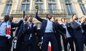 Paul Pogba holds the World Cup trophy aloft during an official reception at the Élysée Palace