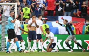 Hungary's Peter Gulacsi celebrates at the final whistle as France's Raphael Varane and Corentin Tolisso look on.