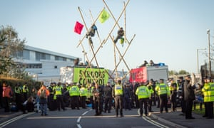 Extinction Rebellion protesters block the entrance to print works owned by Rupert Murdoch in Hertfordshire on Friday.