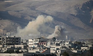 Smoke billows from buildings following Syrian government bombardment of Hamouria in the eastern Ghouta region