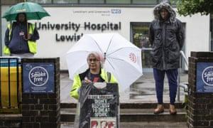 Unite members hold a minute's silence outside Lewisham Hospital
