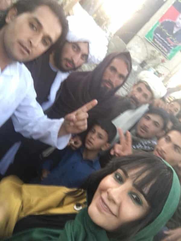 Farzana Wahidy with Taliban fighters