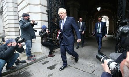 Boris Johson leaves a cabinet meeting
