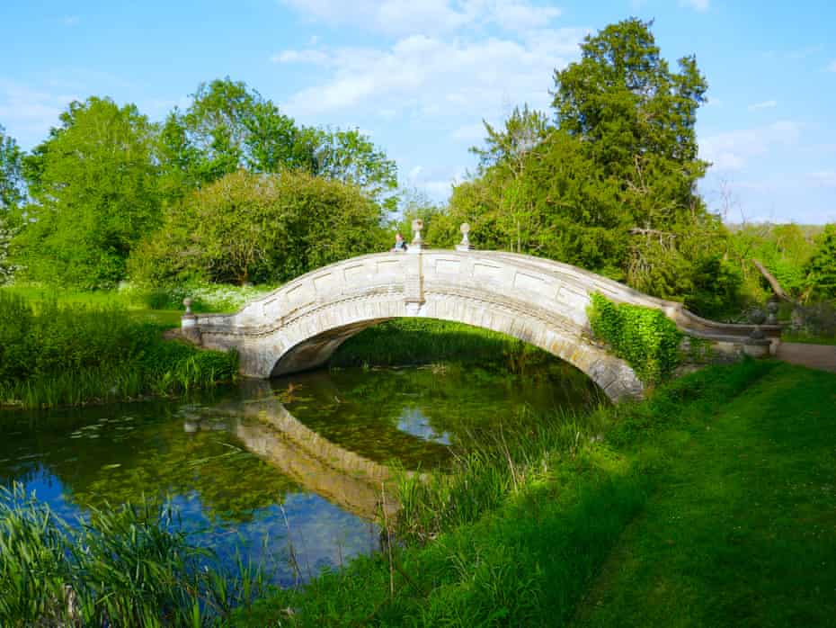 Writer Phoebe Taplin on the estate's Chinese bridge, Wrest Park, Bedfordshire, UK.