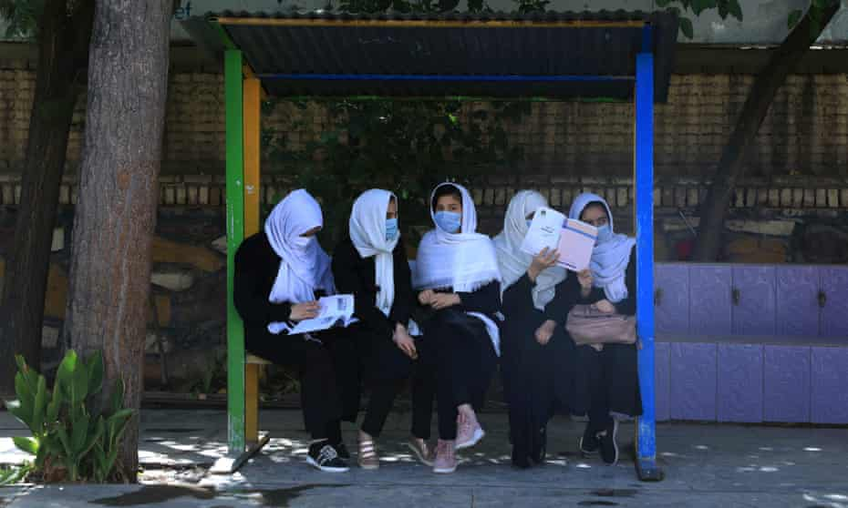 Schoolgirls sit in a schoolyard in Herat this month, following the Taliban takeover of the country.