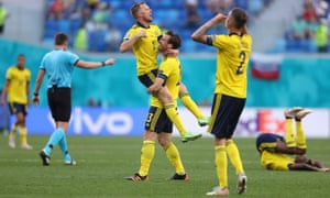Gustav Svensson and Sebastian Larsson and other teammates celebrate Sweden's after the final whistle.