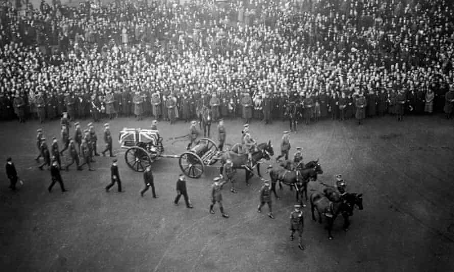 The coffin of the unknown warrior is carried in procession through London on its way to its final resting place at the Cenotaph in Whitehall, 11 November 1920.