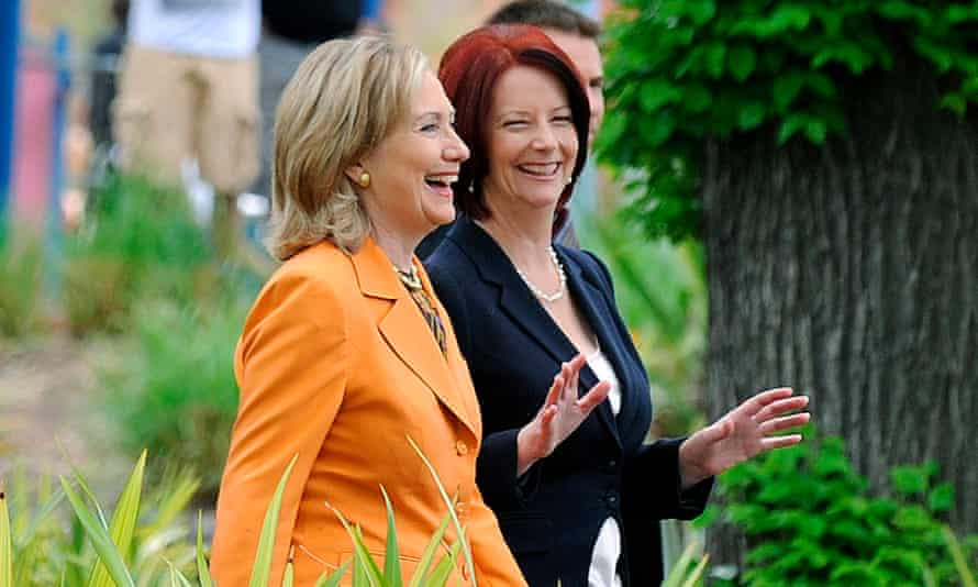 Hillary Clinton and Julia Gillard in Melbourne in 2010. Gillard says Clinton is not immune to the 'curious question of gender'.