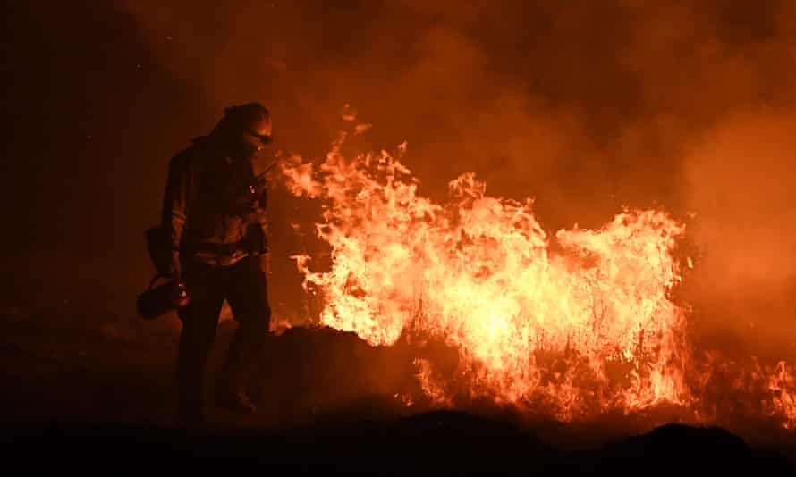 Firefighters lighting backfires as they try to contain the Thomas wildfire in Ojai, California on on December 09, 2017.