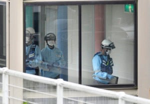 Emergency services personnel inside the care facility where 19 people were killed and dozens more injured.