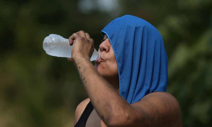 A woman drinks water duing the heatwave that hit Salem, Oregon on 12 August.