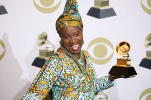 Angelique Kidjo poses in the press room with the Grammy for Best World Music Album.