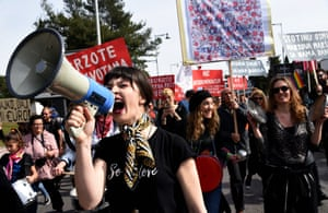 Women and activists take part in a demonstration on International Women's Day in in Podgorica, Montenegro
