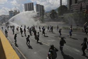 Caracas, VenezuelaRiot police use a water cannon to break up a march in protest against president Nicolás Maduro. Uprisings against Maduro's government have left dozens dead in the last two months. The opposition wants immediate elections and the liberation of political prisoners.