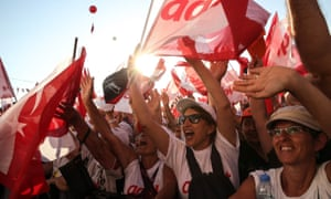 People listen to Turkey's main opposition Republican Peoples Party (CHP) leader Kemal Kilicdaroglu delivering a speech during a rally in Istanbul's Maltepe district.