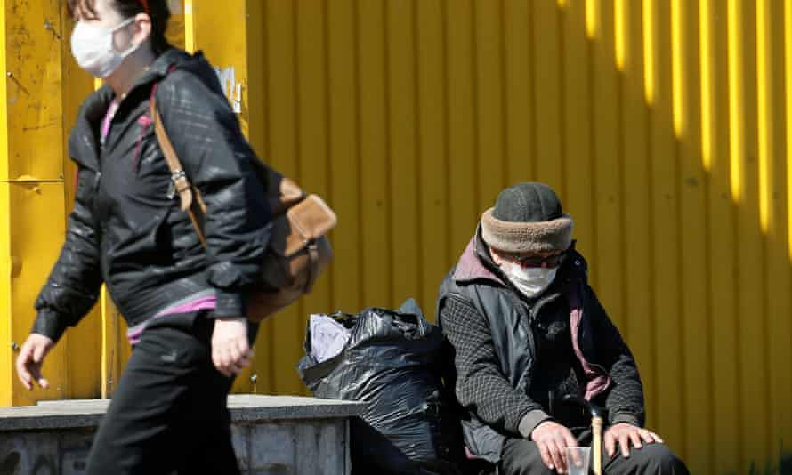 A homeless Ukrainian man begs for money on Monday during a partial lockdown in Kiev.