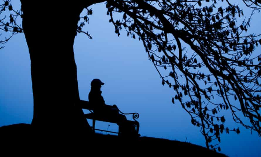 A person sitting alone on a bench.