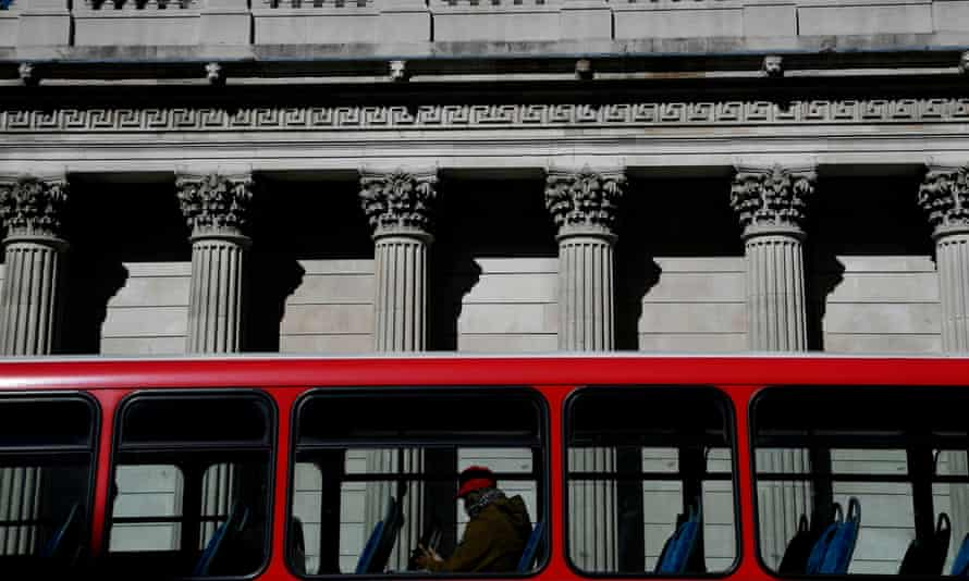 A near-empty bus passes the Bank of England.